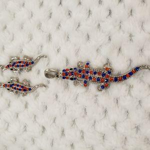 Alligator pendant and earrings. Blue, orange ston
